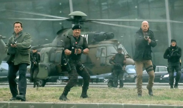 Arnold-Schwarzenegger-Sylvester-Stallone-and-Bruce-Willis-in-The-Expendables-2-2012-Movie-Image1-600x354